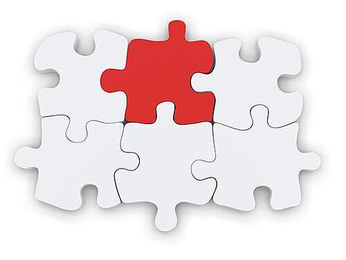 rotes puzzleteil in weißem puzzle
